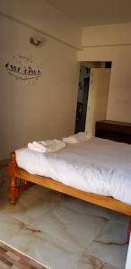 A bed or beds in a room at Asian Bay View