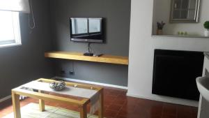 A television and/or entertainment center at Queen Bariloche