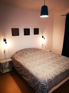 Un ou plusieurs lits dans un hébergement de l'établissement Appartement Spacieux