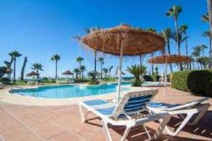 The swimming pool at or near Luxury Apartment Alcazaba Beach
