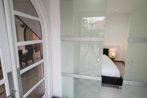 Un ou plusieurs lits superposés dans un hébergement de l'établissement Appartements meublés proches Nancy