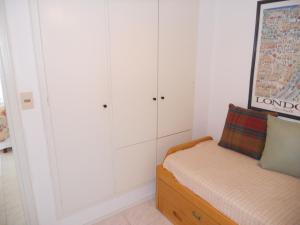 Cama o camas de una habitación en Torre Madison