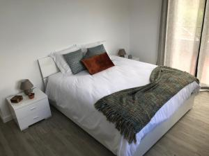 A bed or beds in a room at Casa Gama