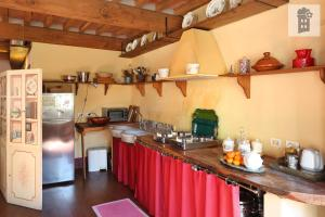 A kitchen or kitchenette at l'attico di delfina