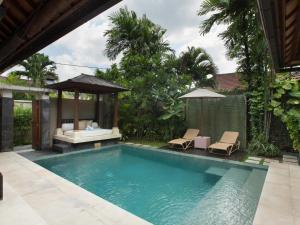 The swimming pool at or near DISINI Luxury Spa Villas