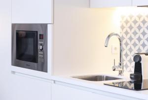 A cozinha ou kitchenette de HM - Ribeira São João Apartment - 6L