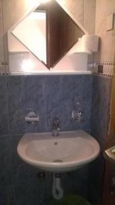 A bathroom at Apartments Lazar