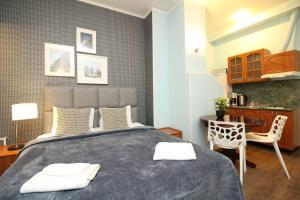 Llit o llits en una habitació de Tallinn City Apartments Residence