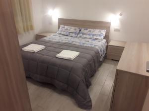 Letto o letti in una camera di Appartamento Chiara