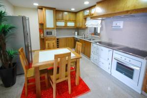 A kitchen or kitchenette at Paradela Villa Sleeps 6 Pool WiFi