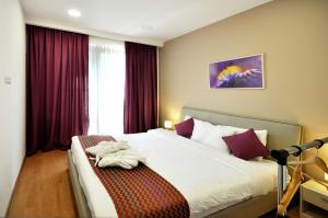 A bed or beds in a room at BFG Suites Apartments