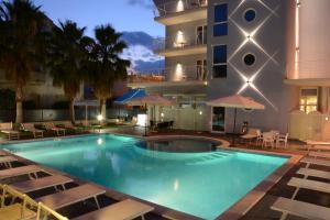 The swimming pool at or close to Kiara Residence