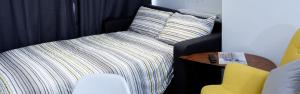 A bed or beds in a room at Winton Apartments