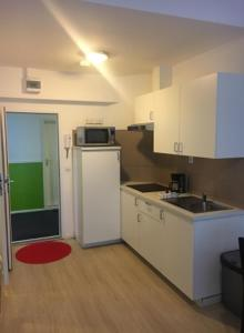 A cozinha ou kitchenette de The Hague Shortstay