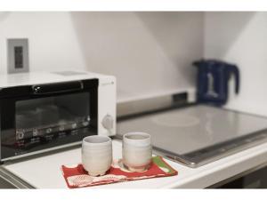 京の宿enにあるキッチンまたは簡易キッチン