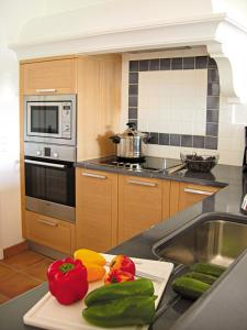 A kitchen or kitchenette at Lagrange Vacances Carré Beauchêne