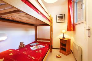 Un ou plusieurs lits superposés dans un hébergement de l'établissement Résidence Néméa Les Grands Ax