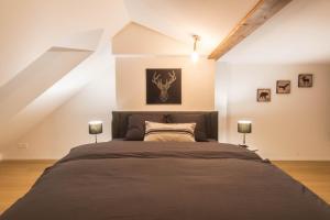 Cama o camas de una habitación en Hirschenplatz Apartments