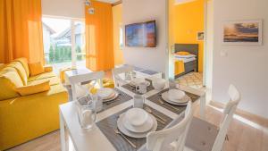 Restauracja lub miejsce do jedzenia w obiekcie Piasek i Woda Apartamenty Butikowe