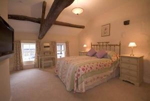 A bed or beds in a room at old farmhouse