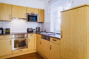 Cucina o angolo cottura di Alpine Resort by Alpin Rentals