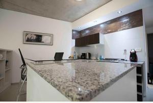 A kitchen or kitchenette at Luxury La Abadía