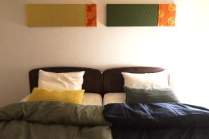 A bed or beds in a room at Kamakura suite