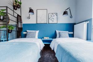 A bed or beds in a room at Mosquito Silesia Apartments