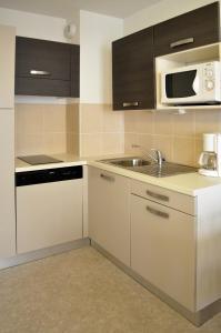 A kitchen or kitchenette at Val d'Azur