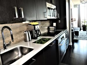 A kitchen or kitchenette at TVHR - Luxury Condos in Heart of Downtown