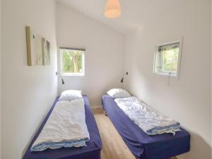 A bed or beds in a room at Holiday home Plantagevej E