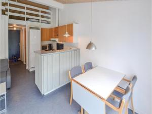 A kitchen or kitchenette at Holiday home Plantagevej A