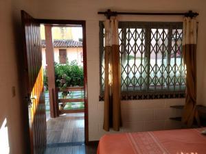 Un balcón o terraza de Casa do Parque Burle