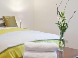 A bed or beds in a room at Duneane Cottage