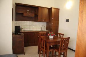 A kitchen or kitchenette at C.A.V. Residenza Prisco