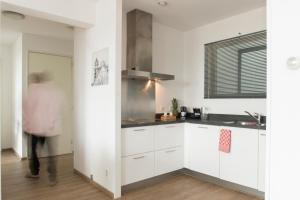 A kitchen or kitchenette at World Fashion Apartments
