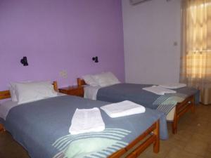Ένα ή περισσότερα κρεβάτια σε δωμάτιο στο Irini Studios