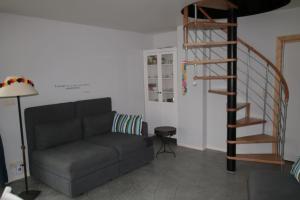 A seating area at Studio confortable à la campagne et proche de la ville
