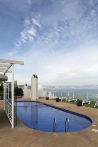 The swimming pool at or near Neruda Mar Suites