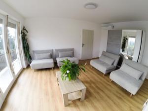 Predel za sedenje v nastanitvi Apartments&Rooms Andrej