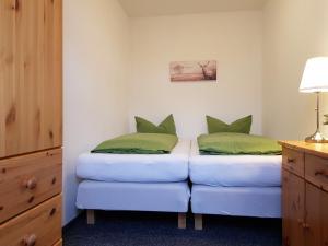 Ein Bett oder Betten in einem Zimmer der Unterkunft Apartments Zum Glasmacher