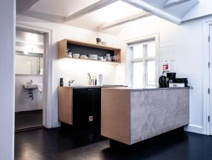 A kitchen or kitchenette at Luna Apartments - Laugavegur 37