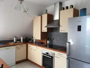 Cuisine ou kitchenette dans l'établissement Votre location aux pieds des Vosges