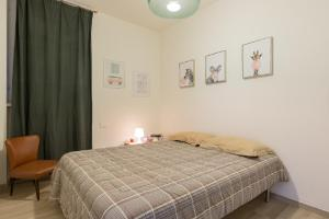 A bed or beds in a room at Casa Mafalda