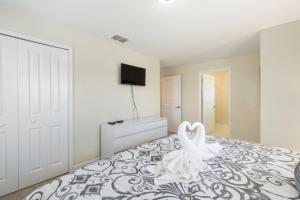 Un ou plusieurs lits dans un hébergement de l'établissement Gatsby Street Townhome #239628 Townhouse