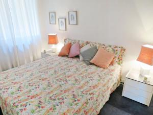 A bed or beds in a room at Locazione turistica Laura