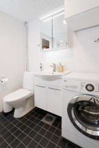 A bathroom at Central Riverside Apartment
