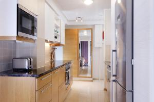 A kitchen or kitchenette at Central Riverside Apartment
