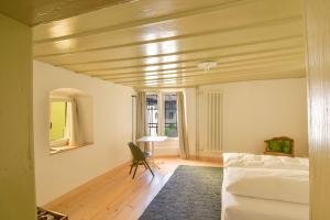 Ein Sitzbereich in der Unterkunft Auberge du Mouton
