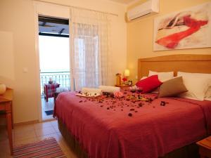 Ένα ή περισσότερα κρεβάτια σε δωμάτιο στο Villa Artemis